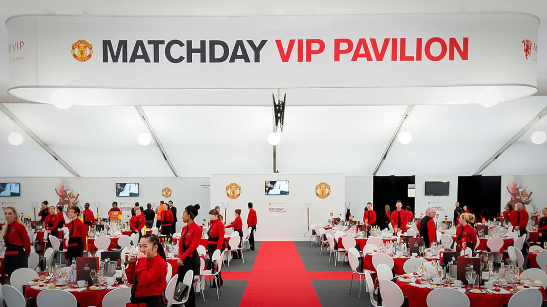 Tension Fabric System Hanging Structures - Sports Signage at Manchester United Stadium