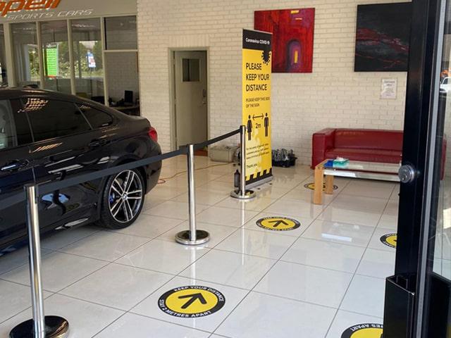Social distancing floor graphics in Volvo car dealership